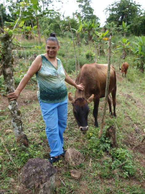 Maria Helena with one of her cows